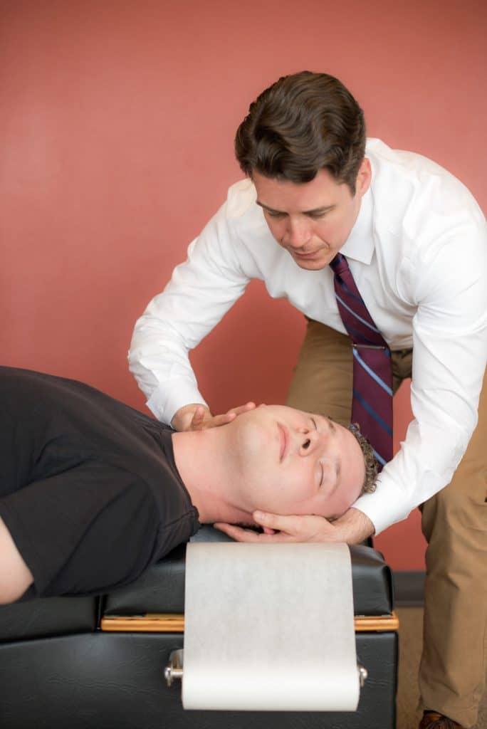 Dr. Phil doing adjustment on Patient
